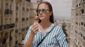 eiffla : Young woman licks ice cream on a summer day