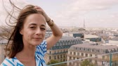 eiffla : French girl in Paris with a view over the rooftops
