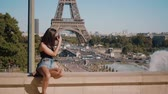 eiffla : Young French woman in the city of Paris with a view over the Eiffel Tower