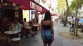 예망 : Young French woman walks through the city of Paris - PARIS, FRANCE - JULY 29, 2019 무비클립