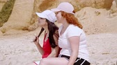 ポルトガル : Summer Sun and Fun at the beach - girls relax and have a great time at the oceanfront 動画素材