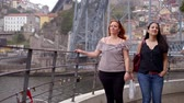ポルトガル : Two women on a sightseeing trip to Porto in Portugal 動画素材