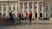 lisszabon : Attractive woman walks over a square at the opera house of Lisbon Stock mozgókép