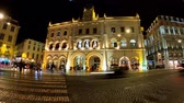 lisszabon : Rossio train station in Lisbon by night - time lapse shot - CITY OF LISBON, PORTUGAL - NOVEMBER 5, 2019