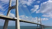 construcción de carreteras : Famous Vasco da Gama Bridge over River Tejo in Lisbon from above - CITY OF LISBON, PORTUGAL - NOVEMBER 5, 2019 Archivo de Video