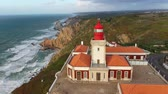 city lifestyle : Famous Cabo da Roca lighthouse at the Atlantic Ocean in Portugal Stock Footage