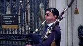 britannia : bagpipe player in the Streets of London - LONDON, ENGLAND - DECEMBER 10, 2019