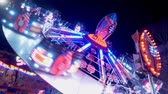 circo : Carousels at amusement fair at night - CARDIFF, WALES - DECEMBER 31, 2019