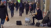 Street musician at Princes Street Edinburgh - EDINBURGH, SCOTLAND - JANUARY 10, 2020