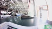 dobrado : conveyor belt in a printing house.