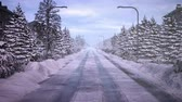 drive on a snowy road. City at daytime. Stock Footage