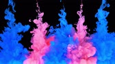 rainbow background : Multicolored composition of ink jets. jets of ink from red and blue colors are mixed in the center of the composition. Colorful abstract combination of acrylic rainbow painted black background. Ink in water, slow motion.