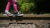 stopy : Little Girl Walking on Train Rails Wideo