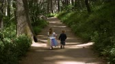 daugther : Siblings walking on the woods Stock Footage