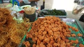 quibe : Buy spicy thai appetizer at market, Thailand (Panning shot)