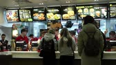 mcdonalds : Minsk, Belarus, January 8, 2018: People order food in a McDonalds Restaurant Stock Footage
