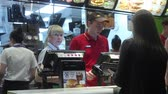 mcdonalds : Minsk, Belarus, April 14, 2018: Visitor orders food and pays credit card at McDonalds restaurant