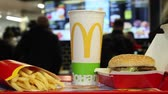 batatas fritas : Minsk, Belarus, May 18, 2017: Big Mac hamburger menu in a McDonalds restaurant on a blurry background of customers ordering food
