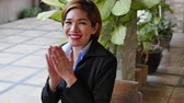 charming : happy business woman applauding, giving thumb up gesture