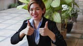happy business woman applauding, giving thumb up gesture