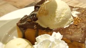 honey pouring on vanilla ice cream with chocolate taost