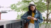 Young beautiful asian woman smiling, happy, talking on the phone. Stock Footage