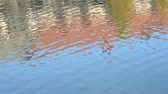 stone wall : Reflection of the buildings on the rippled water surface Stockvideo