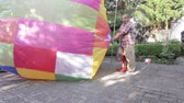 pessoal : CHIANG RAI, THAILAND - DECEMBER 14: Unidentified people inflate a hot air balloon at old folks home on December 14, 2014 in Chiang rai, Thailand.