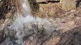drench : Extreme close up of heavy water pounding into ground