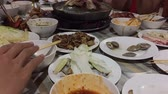 ingredient : timelapse closeup people eating buffet Korean barbecue in Thailand, NTSC, 30 fps, horizontal,