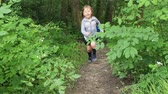 Boy and girl running quickly on a narrow path in a forest in summer Vídeos