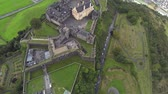 battlements : Three scenes of camera flying over Stirling castle in Scotland.