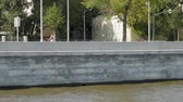 пейзаж : Girl roller skating on river embankment on sunny summer day