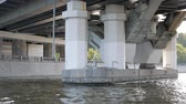 歴史的価値のある : View on massive structure under bridge from passing boat.