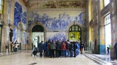 cobalt blue : Porto, Portugal - January, 18: Group of tourists at the railway station. Stock Footage