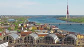 riga : Beautiful view of the city of Riga, Latvia. View of the Old Market, the River Daugava and the TV Tower