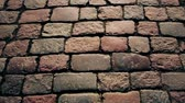 parede de tijolos : cobbles on the pavement in the old town