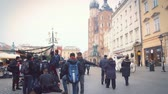 több színű : Krakow, Poland - January 18: Tourists stroll along the beautiful street in the old town. A group of young people communicates on the grounds near the Church of St. Mary.