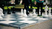 szachy : Teenagers play big street outdoor chess