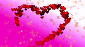 gap : Glowing red heart from particles on a bright background. Stock Footage