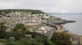 sky : View of Mousehole fishing village Cornwall England UK Stock Footage