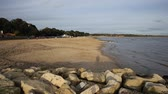 christchurch : Mudeford beach near Christchurch Dorset England UK with rocks in foreground PAN Stock Footage