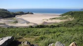 manzara : Three Cliff Bay south coast the Gower Peninsula Swansea Wales uk near to Oxwich Stok Video