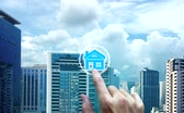 banking house : Finger touch with property investment icons over the Network connection on property background, Property investment concept.