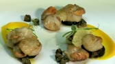 deep sea shrimps : New Zealand Marlborough Scallops. chef preparing entree dish