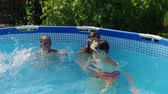 sister : Weekend. Swimming pool. Children playing in the pool. Slow motion. HD