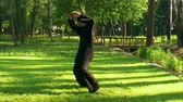 quimono : An adult man practicing qigong rotating steel sword around body. Slow motion. HD