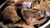 braised dishes : Cooking on the open fire. Grilled pieces of river fish in a metal deep plate. HD