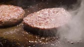 cooking : Chef turning over beef or pork cutlets grilling on grid. Slow motion. HD Stock Footage