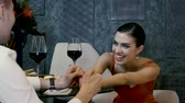 vinho tinto : The young pretty woman and man holding hands on the dating at restaurant. 4K